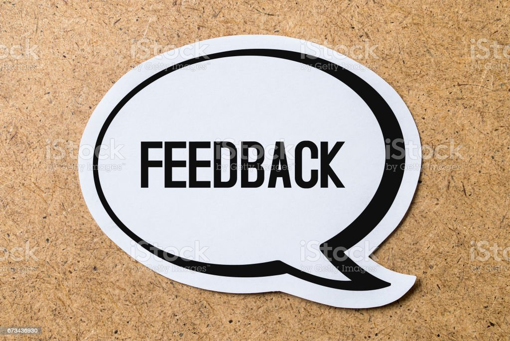 Feedback text in a speech bubble cut from paper or cardboard. Useful icon styled design to website or social media for business. stock photo