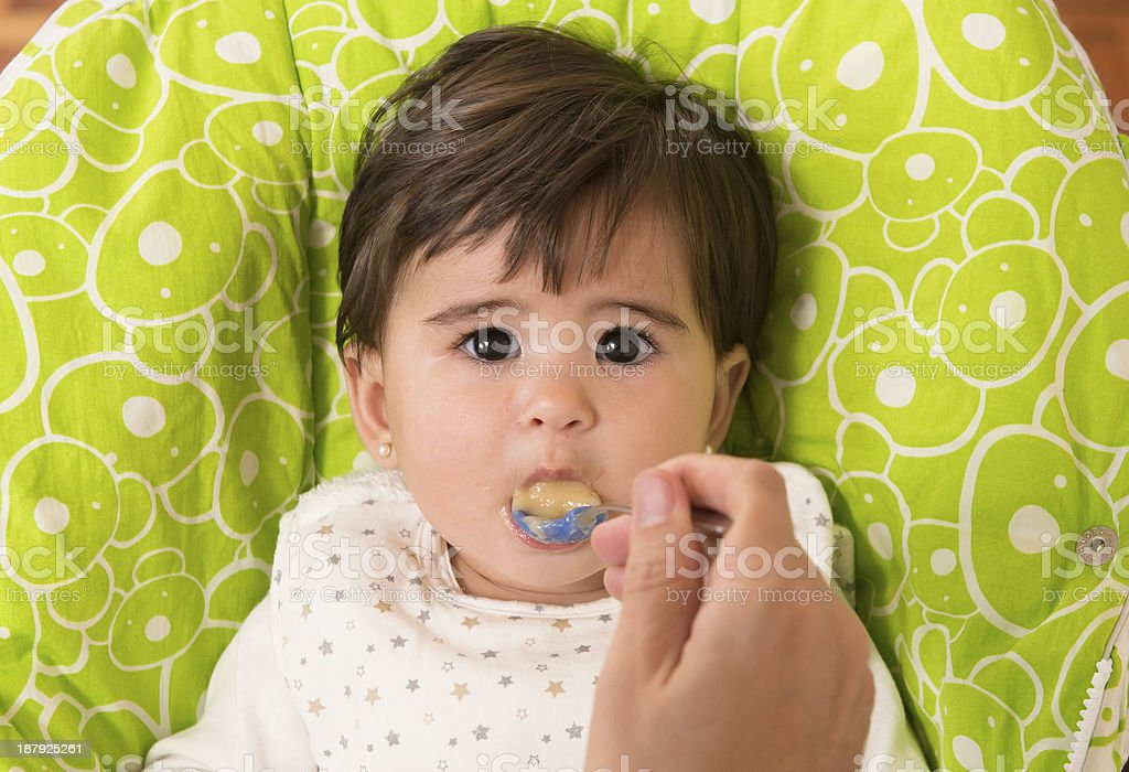 Feeding a cute Lovely Baby Girl royalty-free stock photo