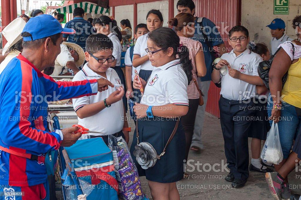 Feeding a sugar addiction stock photo