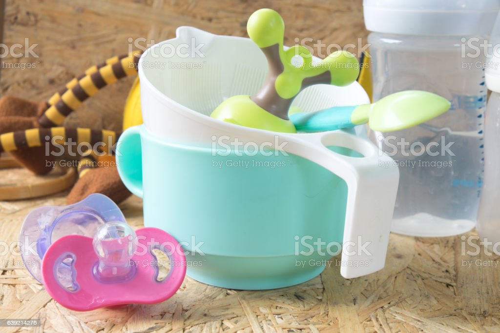 Feeding baby accessories - bottles, teats on wood table stock photo