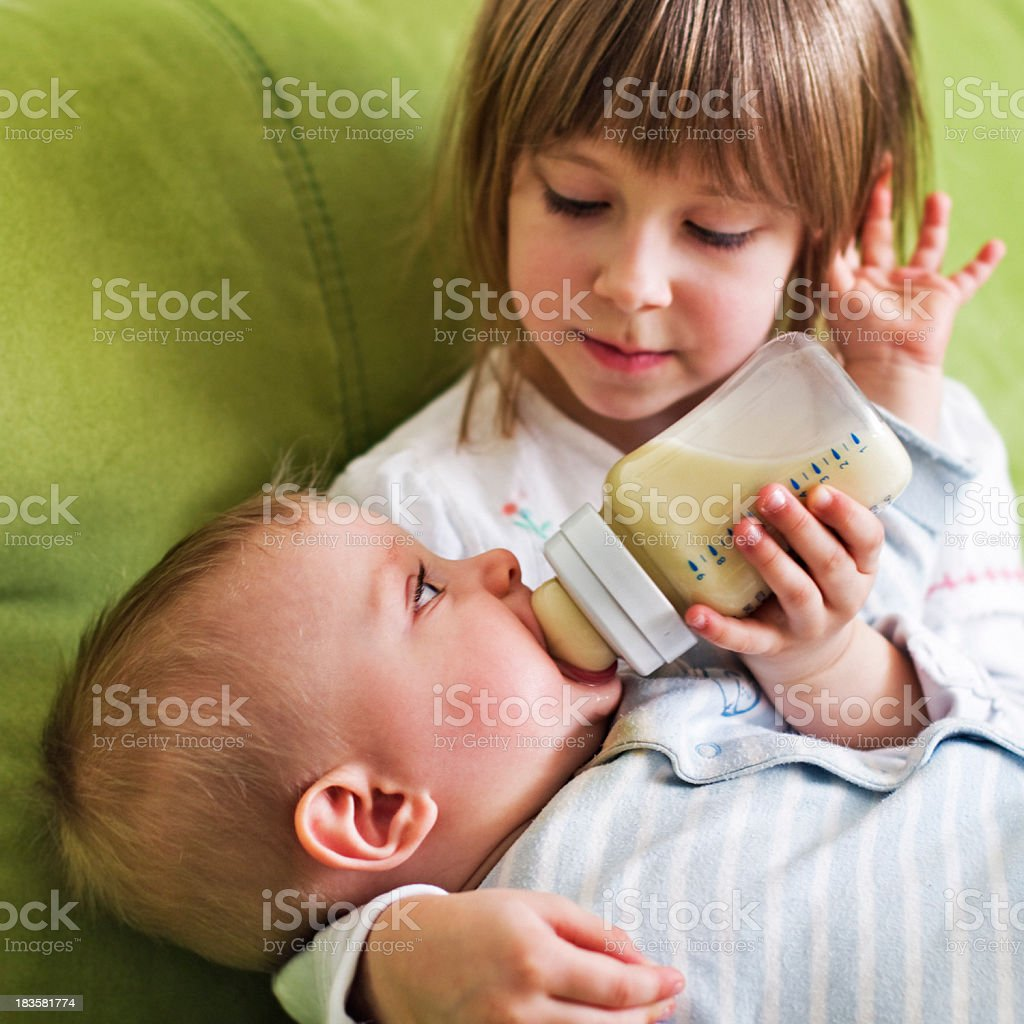 Feeding baby brother royalty-free stock photo