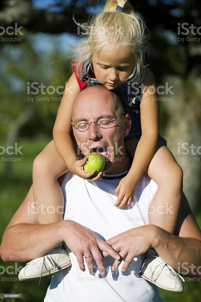 Feeding Daddy royalty-free stock photo