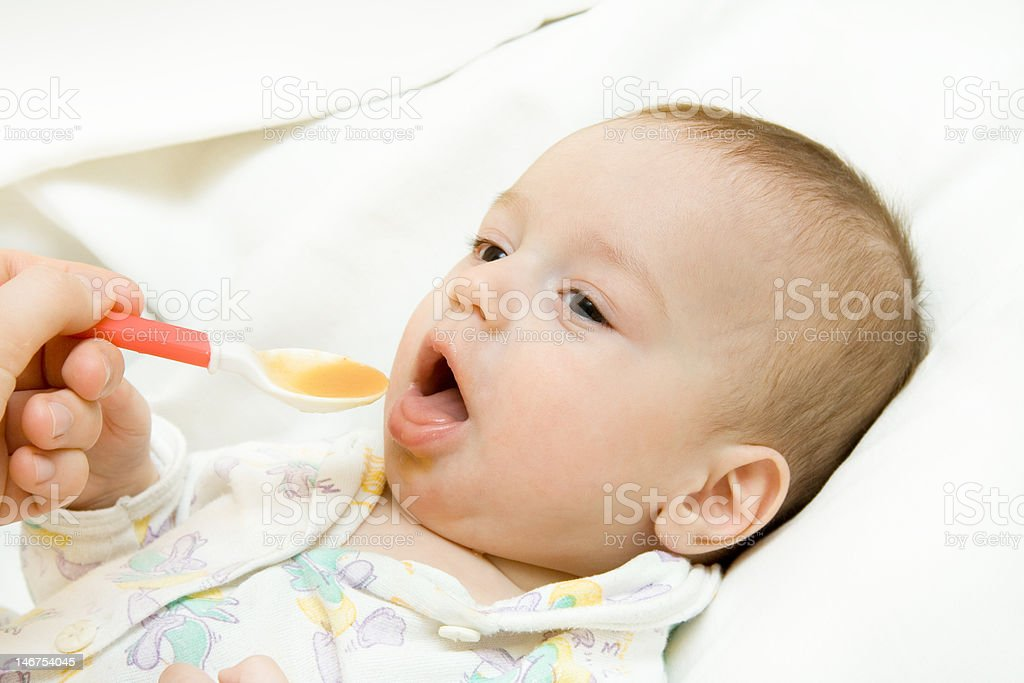 Feeding of the child royalty-free stock photo
