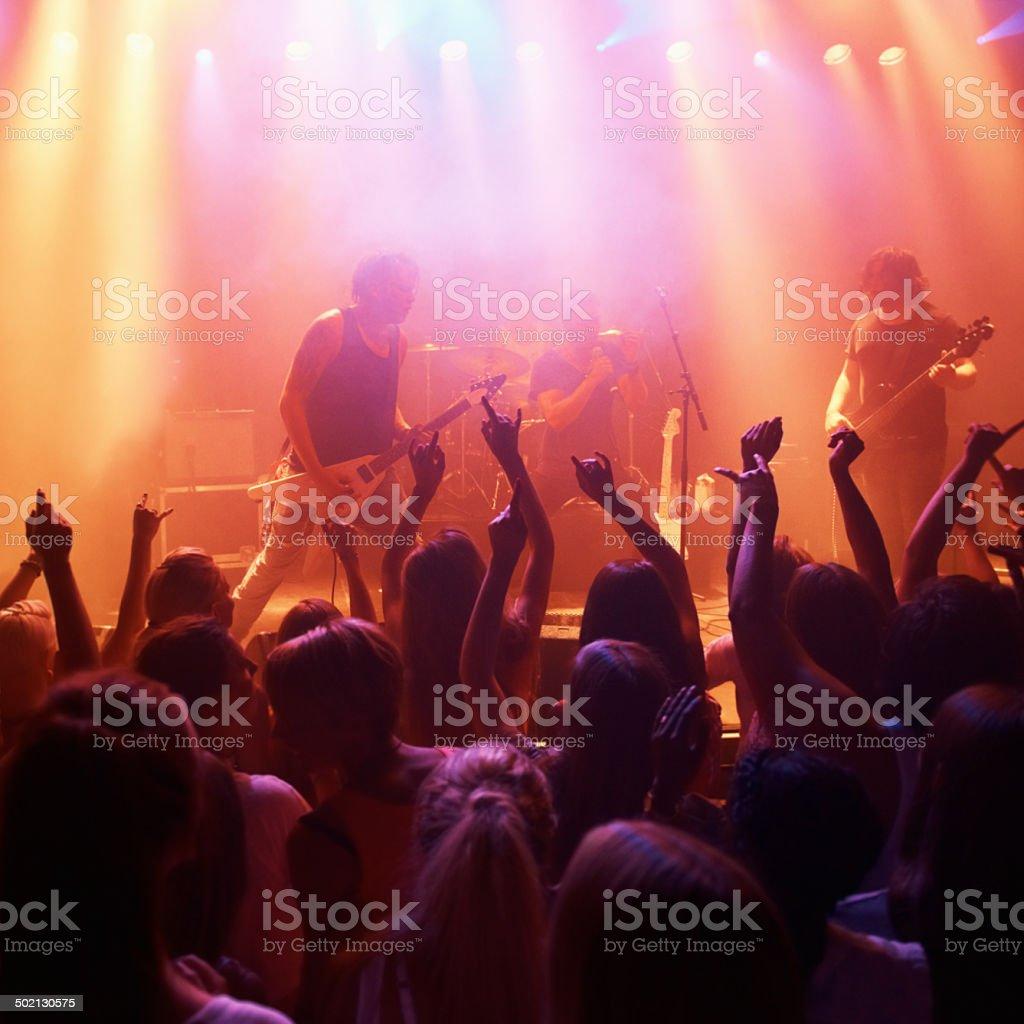 Feeding off the crowd's vibe stock photo