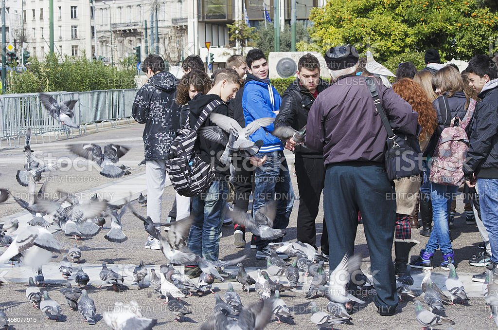 Feeding pigeons in Athens royalty-free stock photo