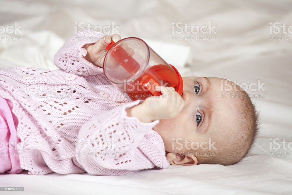 Feeding procedure of little baby royalty-free stock photo