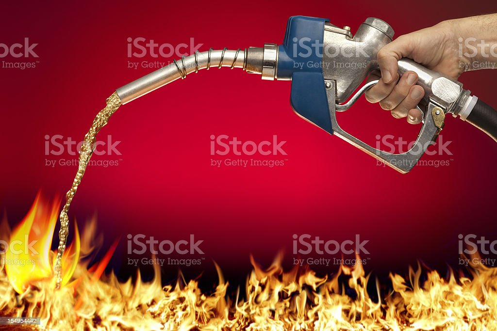 Feeding the Flame; Putting Gasoline on Fire stock photo