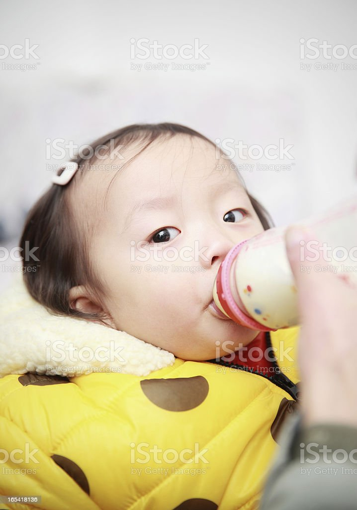 Feeding with baby bottle royalty-free stock photo