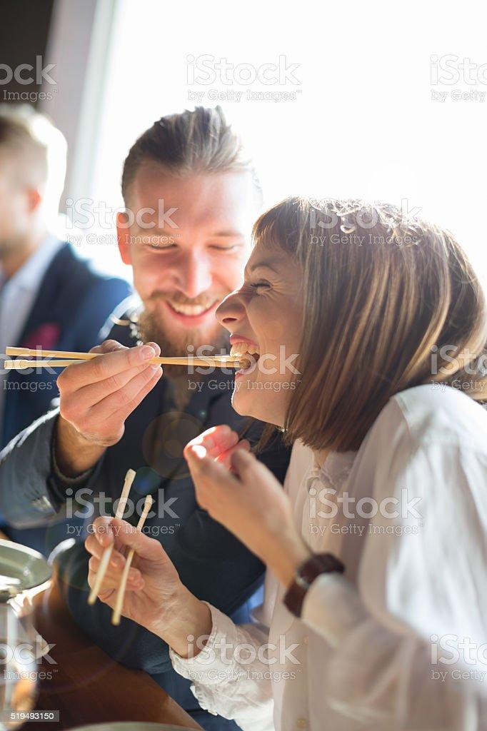 Feeding with sushi stock photo