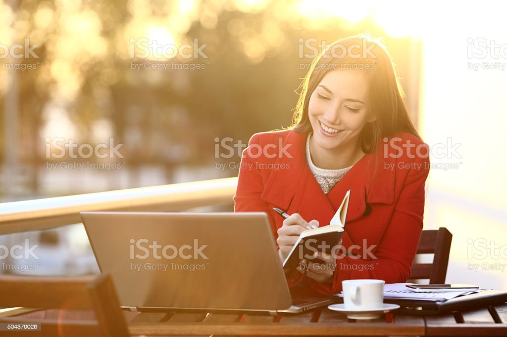Feelancer working with laptop in winter stock photo