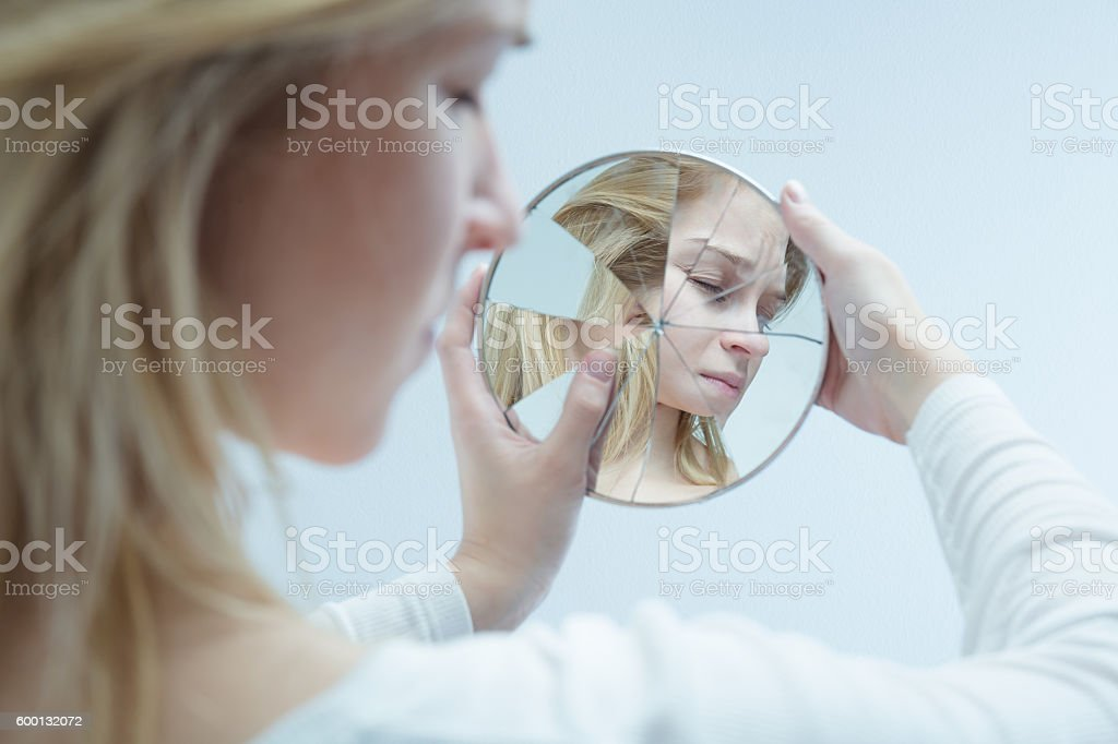 Feeling at war with herself stock photo