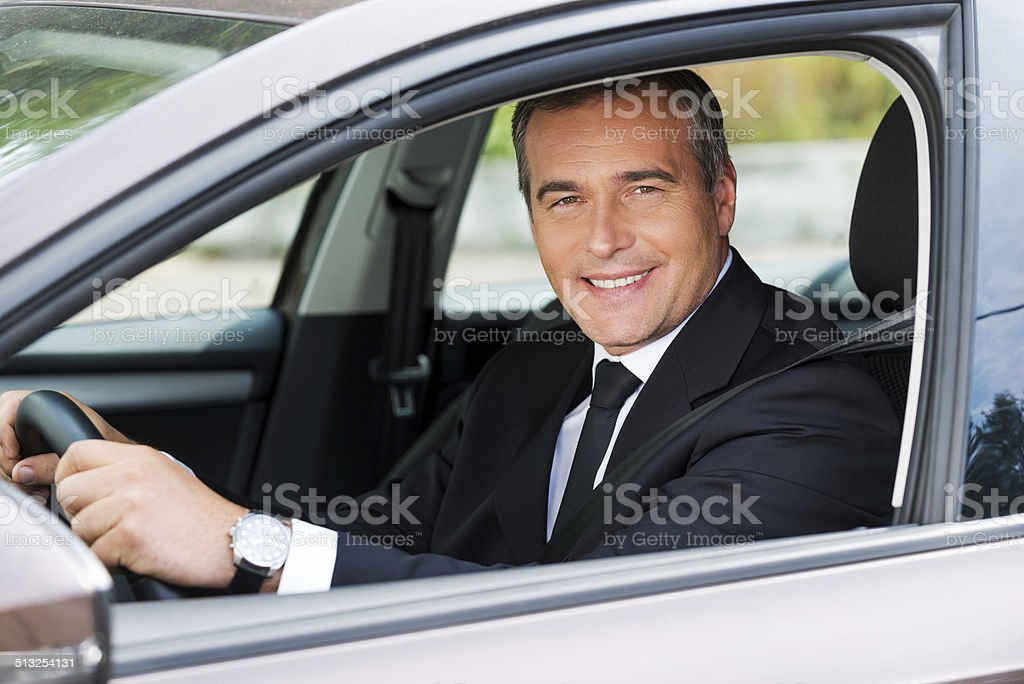Feeling comfortable in his new car. stock photo