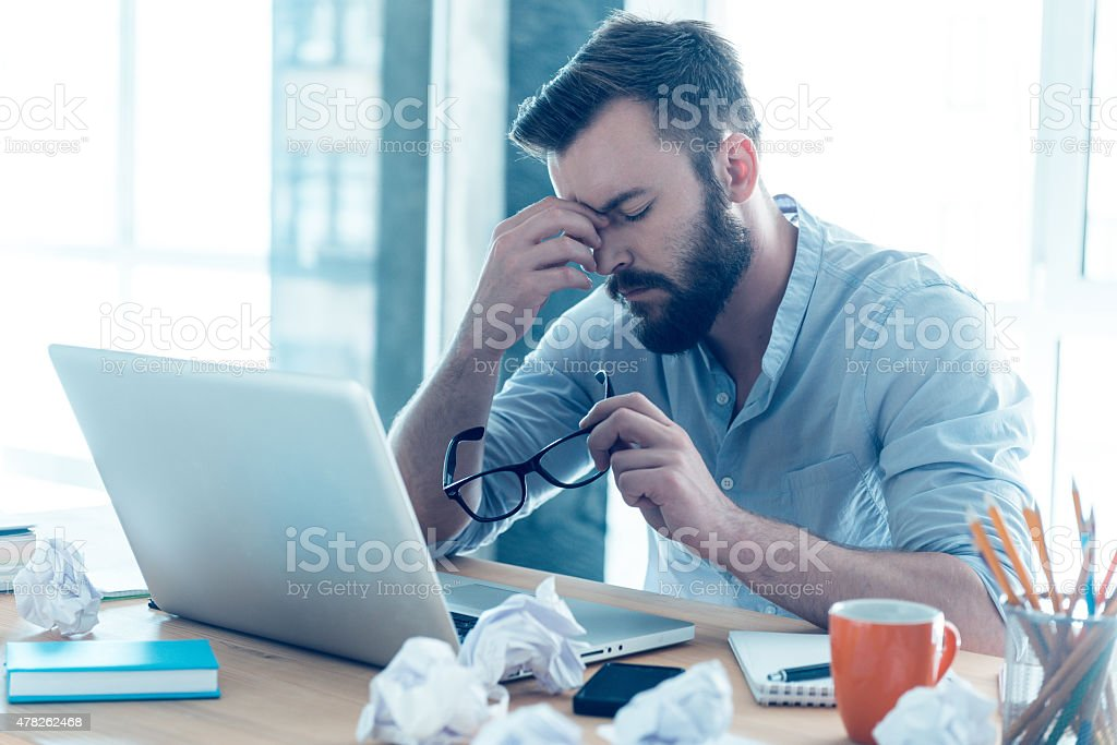 Feeling exhausted. stock photo