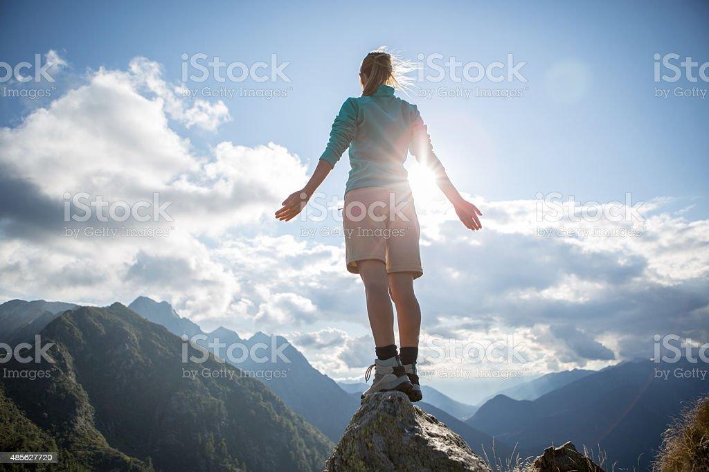 Feeling free on top of mountain stock photo