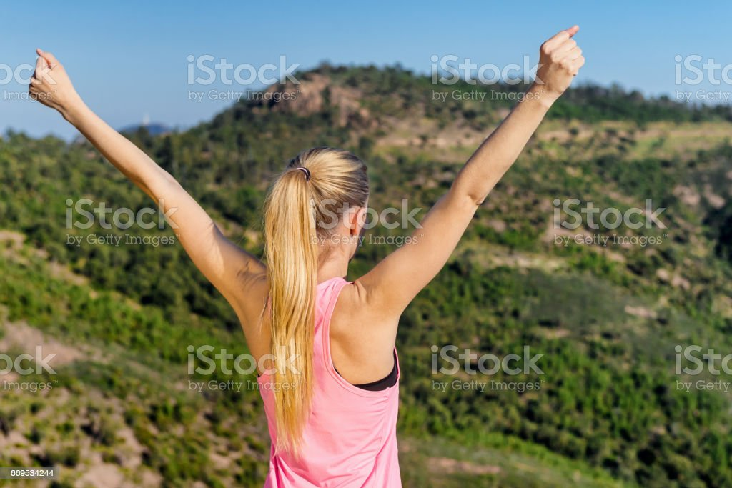 Feeling free with open arms stock photo