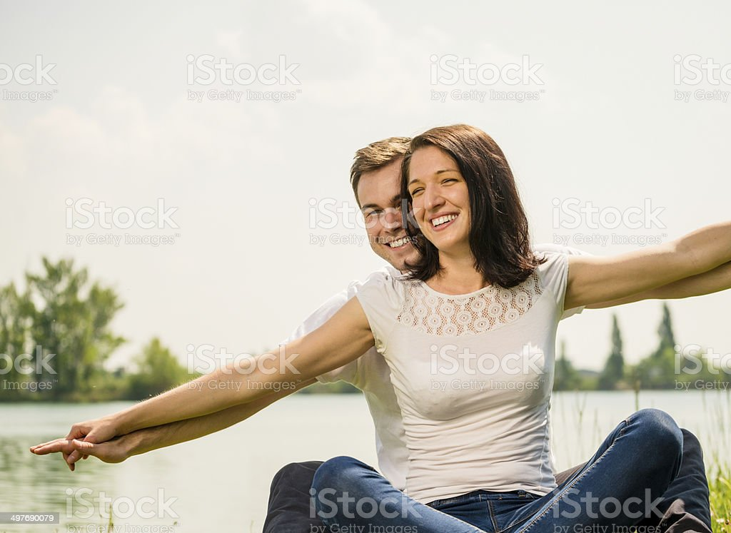 Feeling free - young happy couple royalty-free stock photo