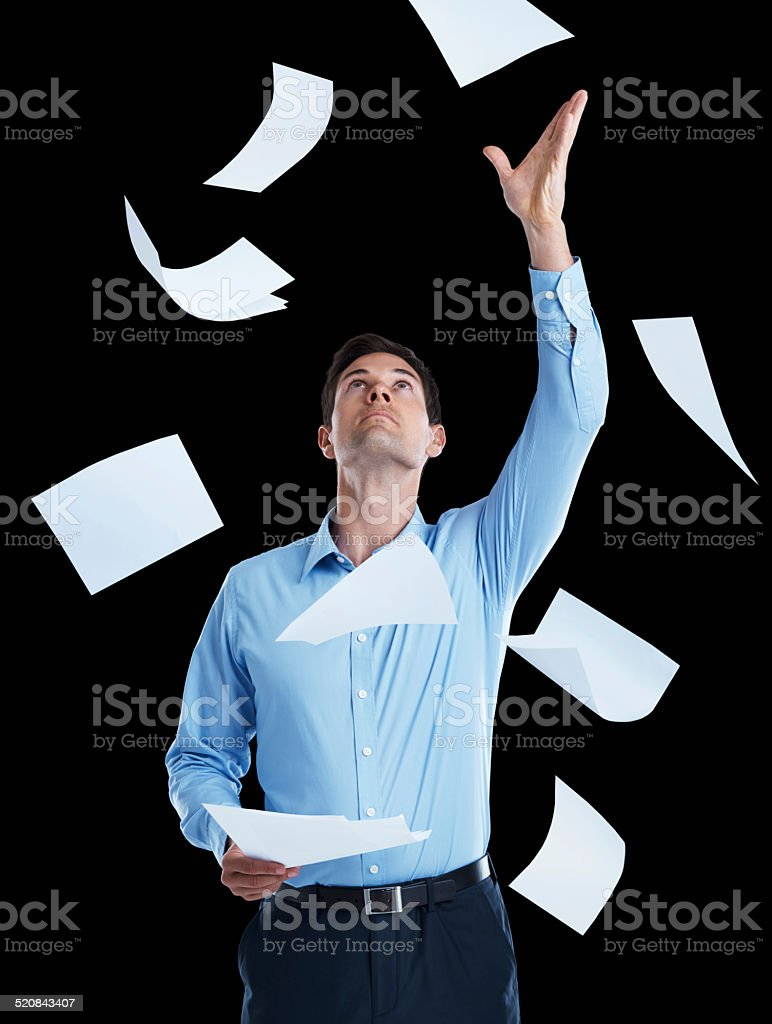 Feeling overwhelmed by all the paperwork stock photo