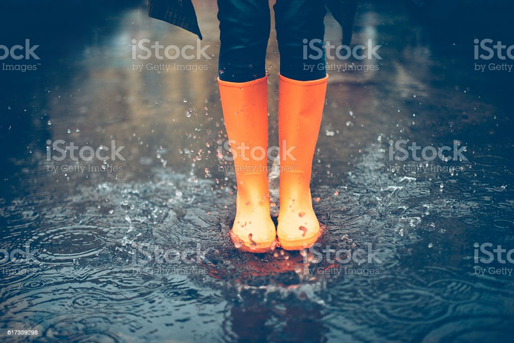 Feeling protected in her boots. stock photo