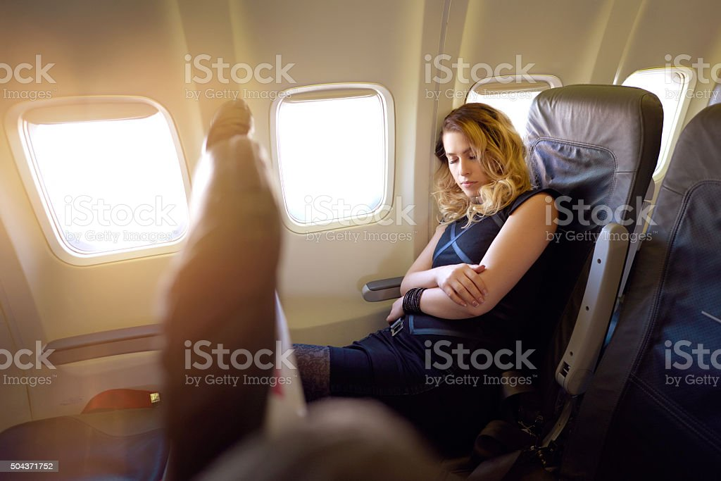 feeling so tired in the airplane stock photo