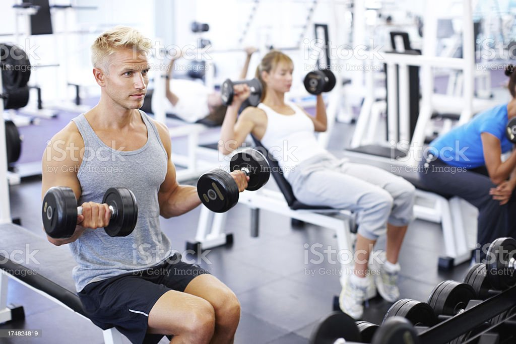 Feeling the burn in both arms royalty-free stock photo