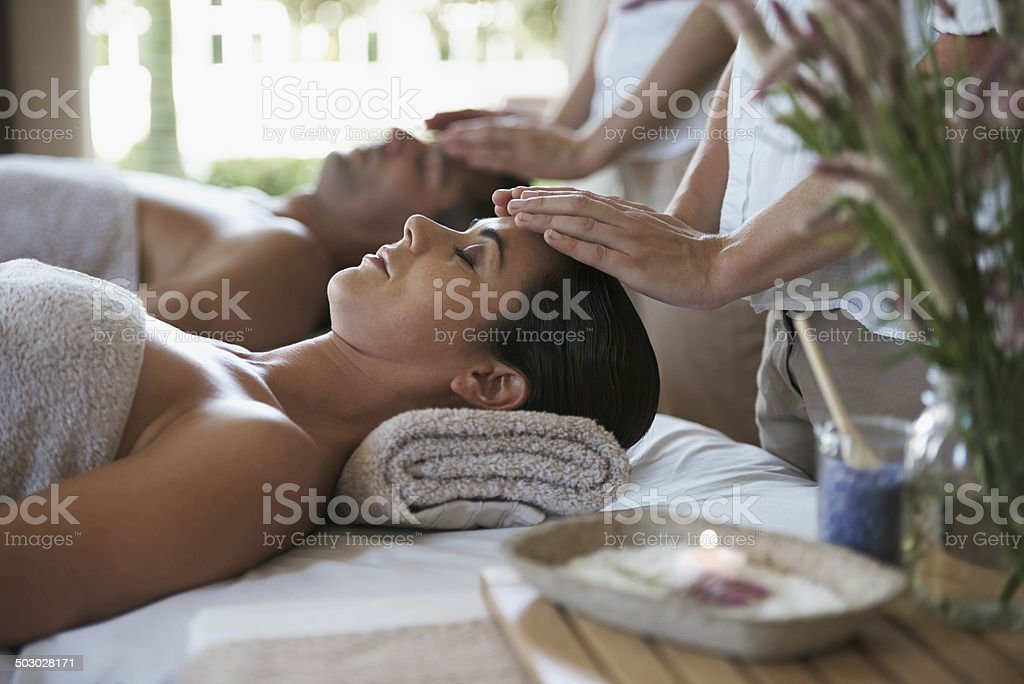 Feeling the healing through their expert hands stock photo
