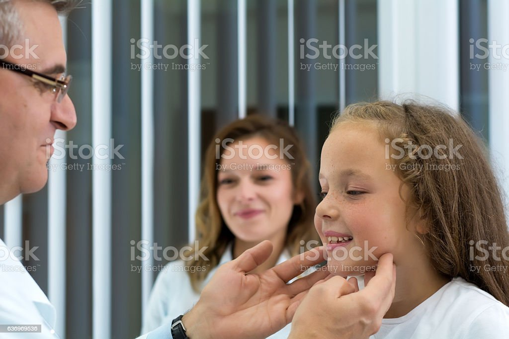 Feeling the neck glands stock photo