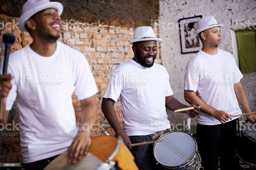 Feeling the rhythm in their drums stock photo