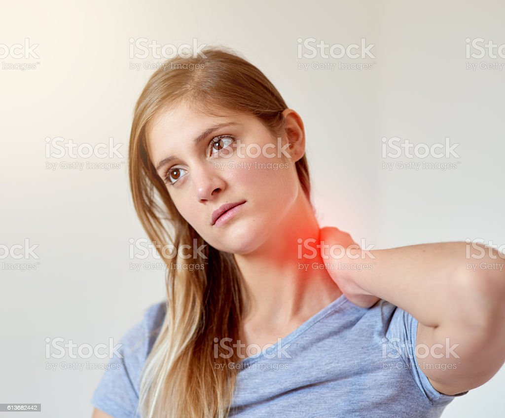 Feeling the strain and tension in her neck stock photo
