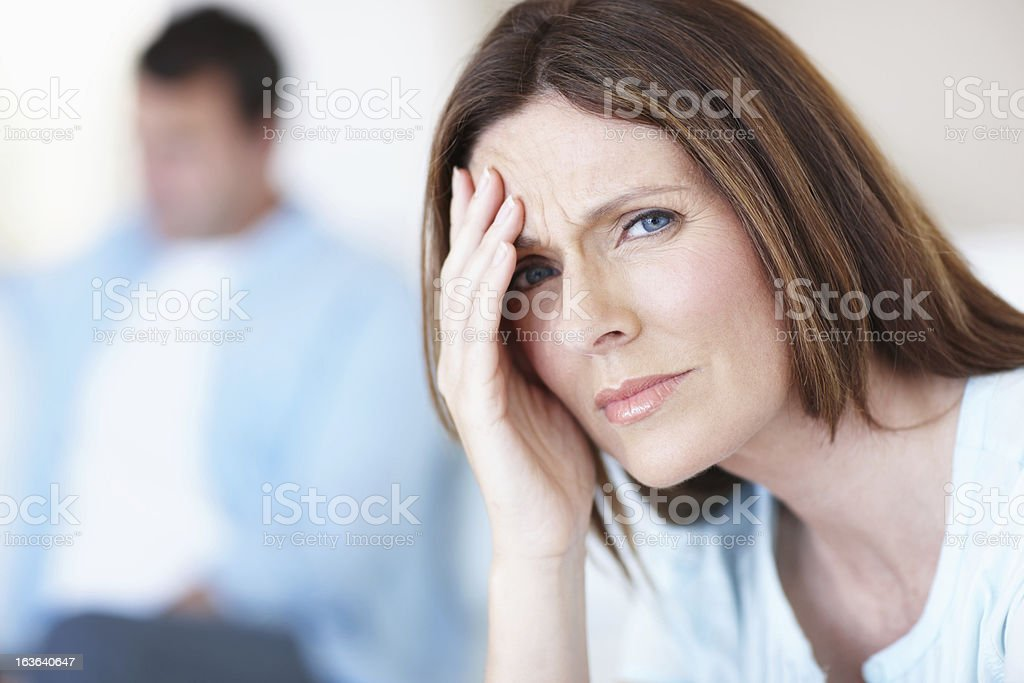 Feeling the strain of a difficult marriage stock photo