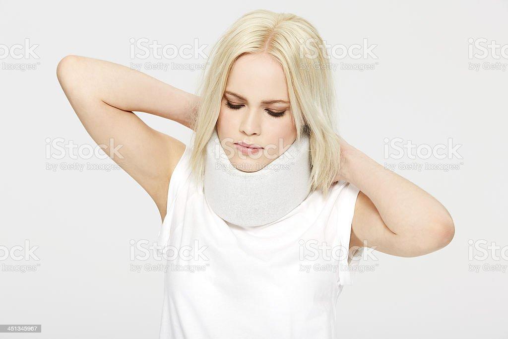 Feeling the strain on her neck stock photo