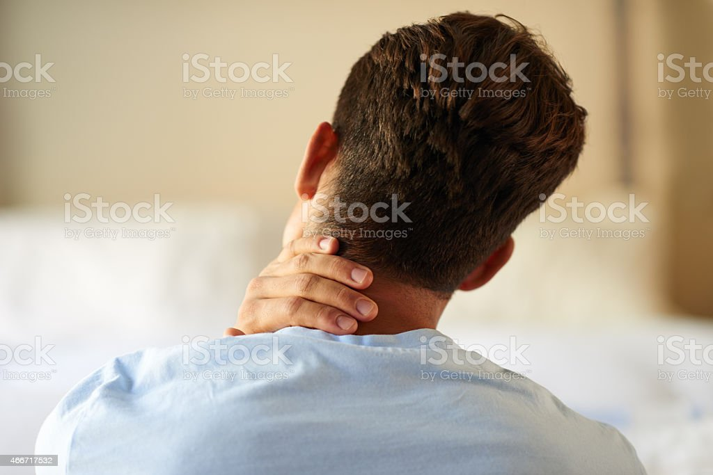 Feeling the tension in his body stock photo