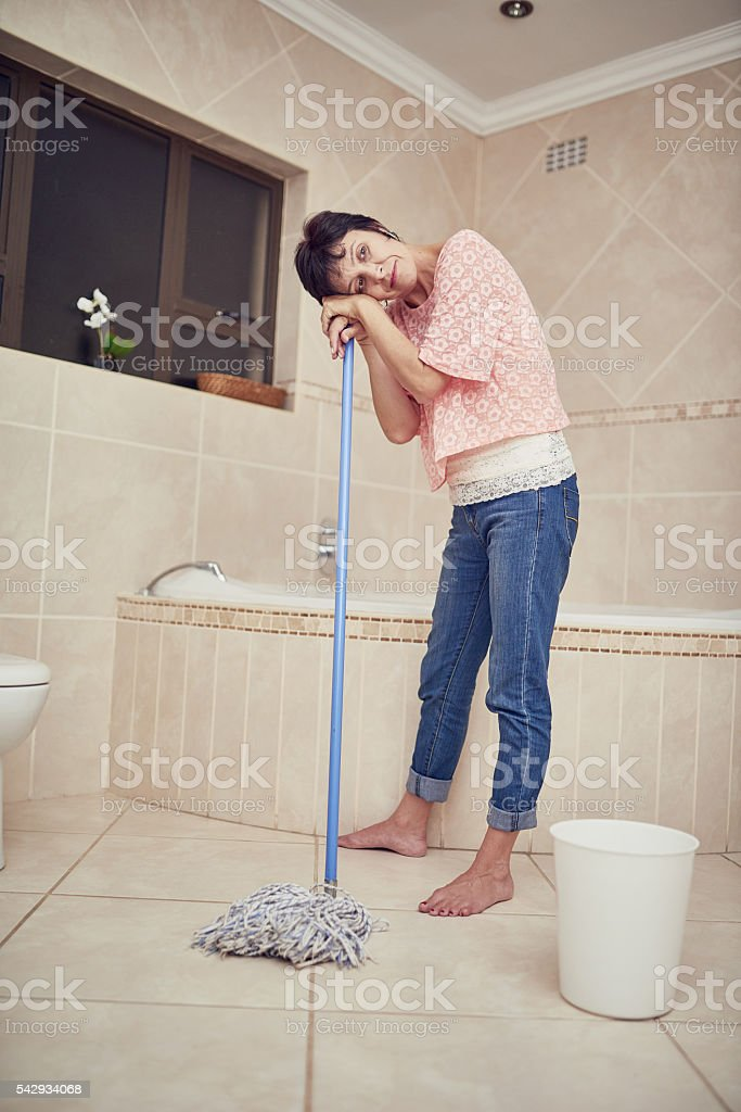 Feeling weary from housework stock photo