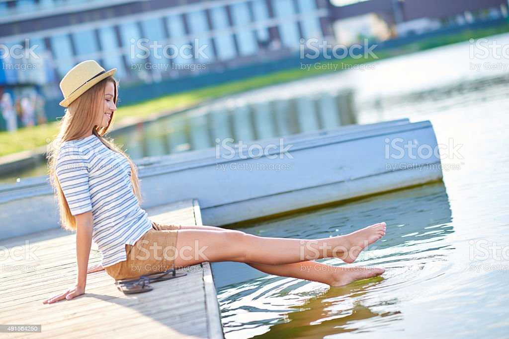 Feels good to get my feet wet stock photo