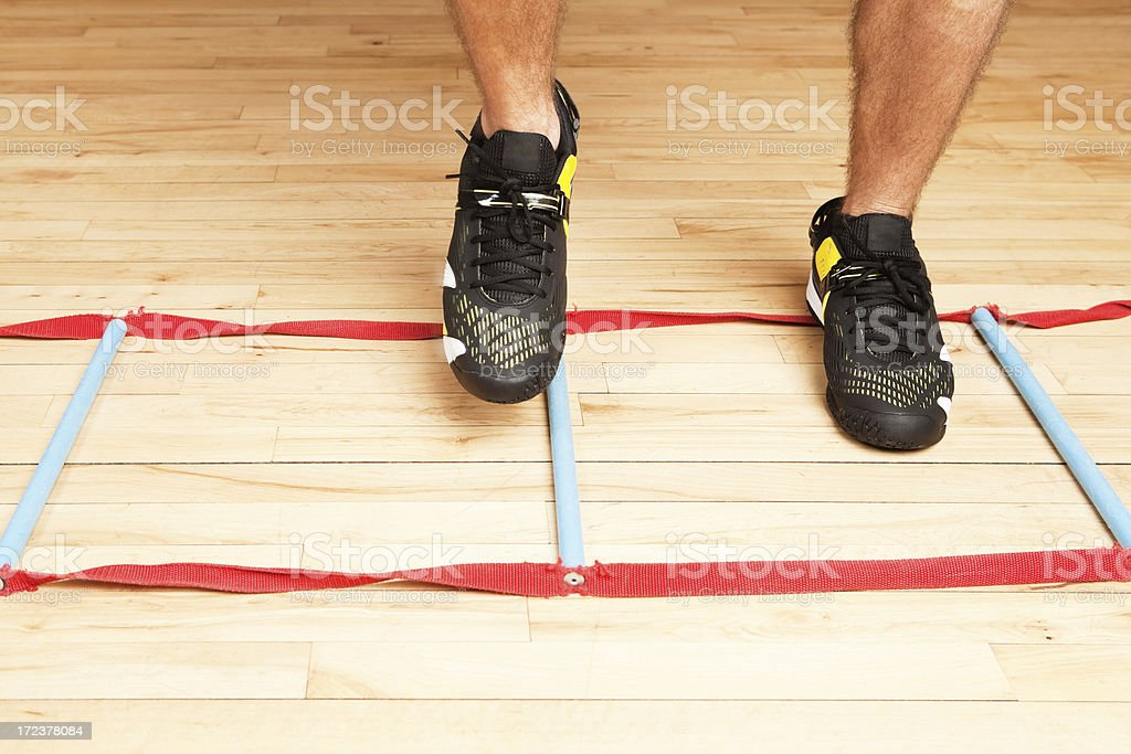 Feet Agility Ladder Workout on Gym Floor royalty-free stock photo