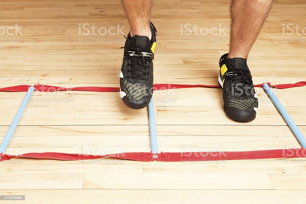 Feet Agility Ladder Workout on Gym Floor stock photo