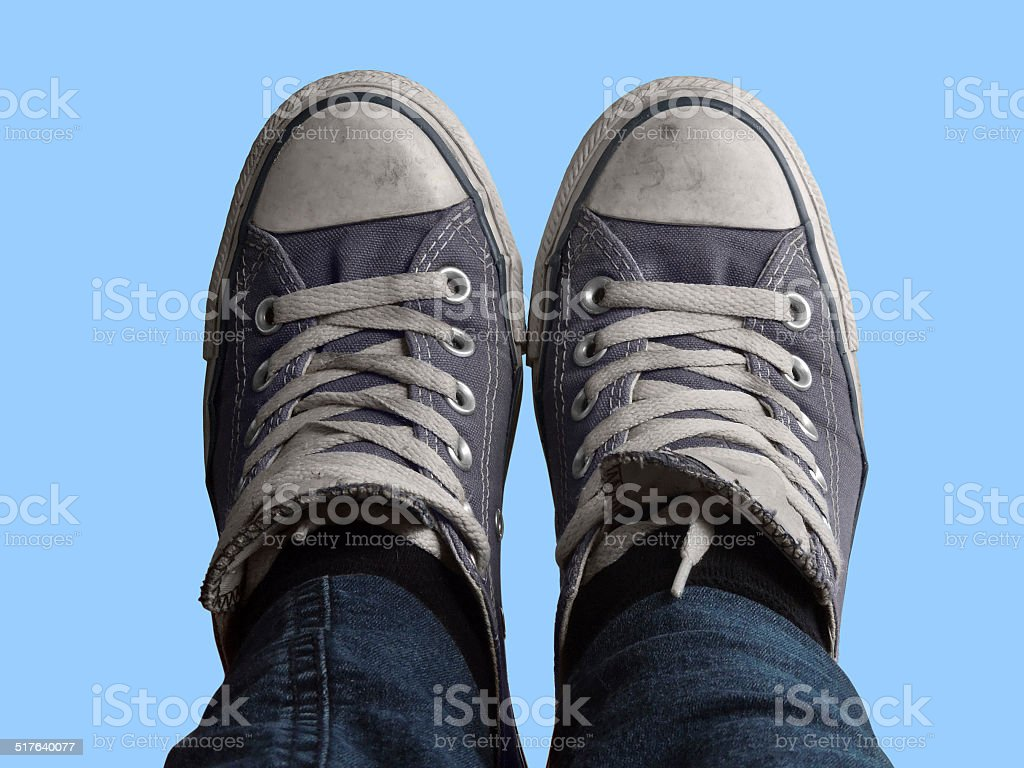 feet and blue sky stock photo