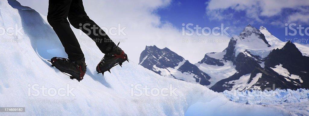 Feet and Crampons of Mountain Climber on Perito Moreno Glacier royalty-free stock photo