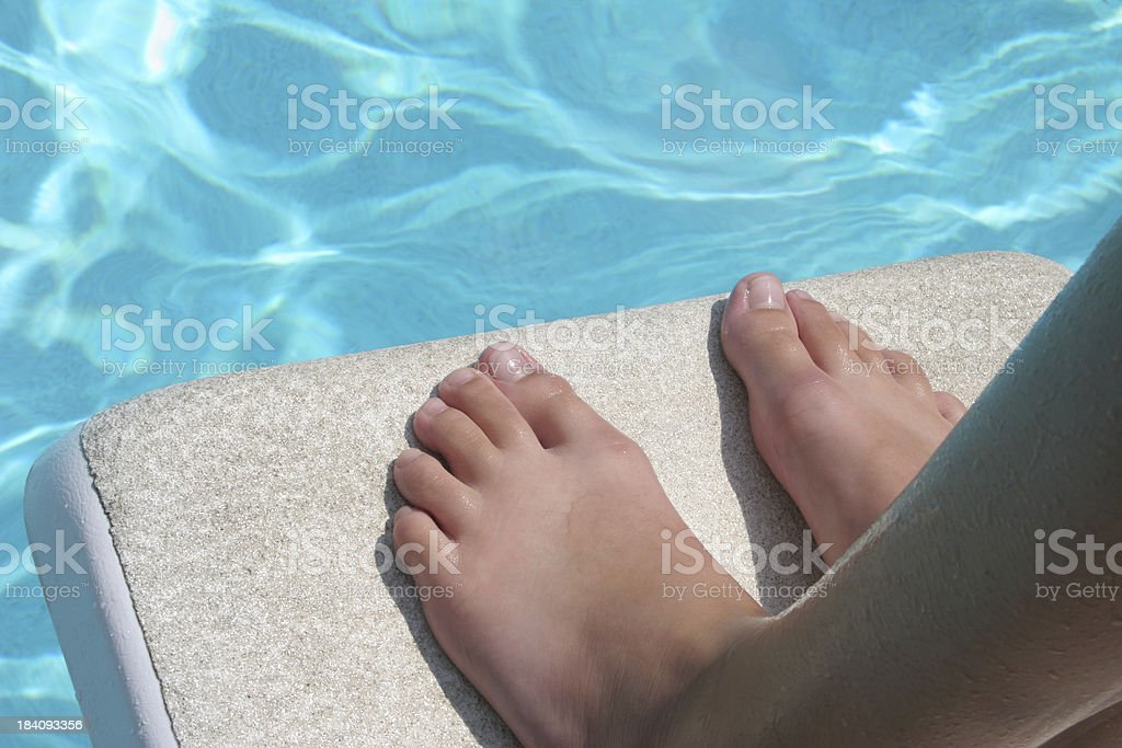 Feet and diving board stock photo