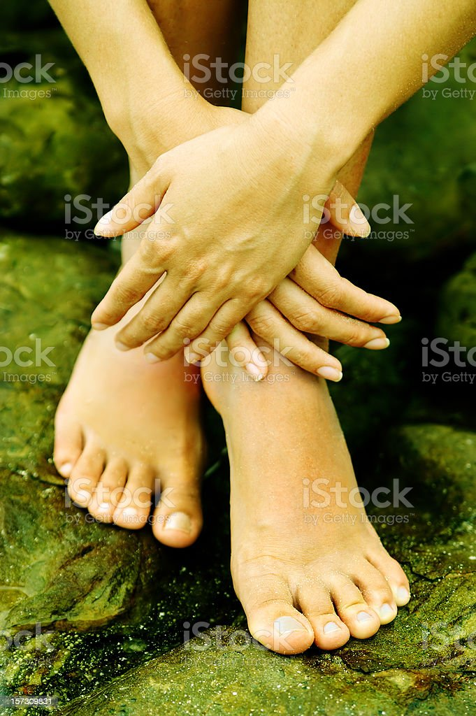feet and hands stock photo