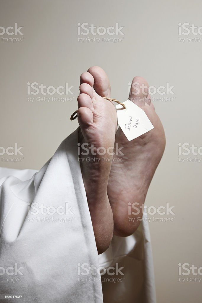 Feet and label of unknown body John Doe in mortuary stock photo