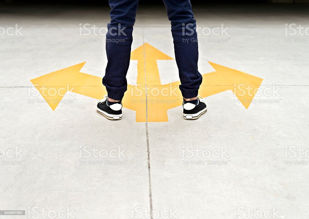 Feet and three arrows painted on floor stock photo