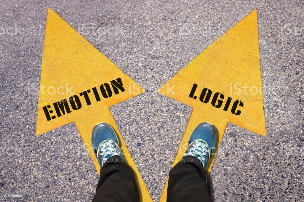 Feet and words Emotion and Logic painted on road stock photo