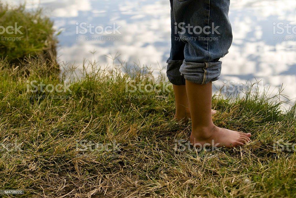 Feet at pond's edge royalty-free stock photo