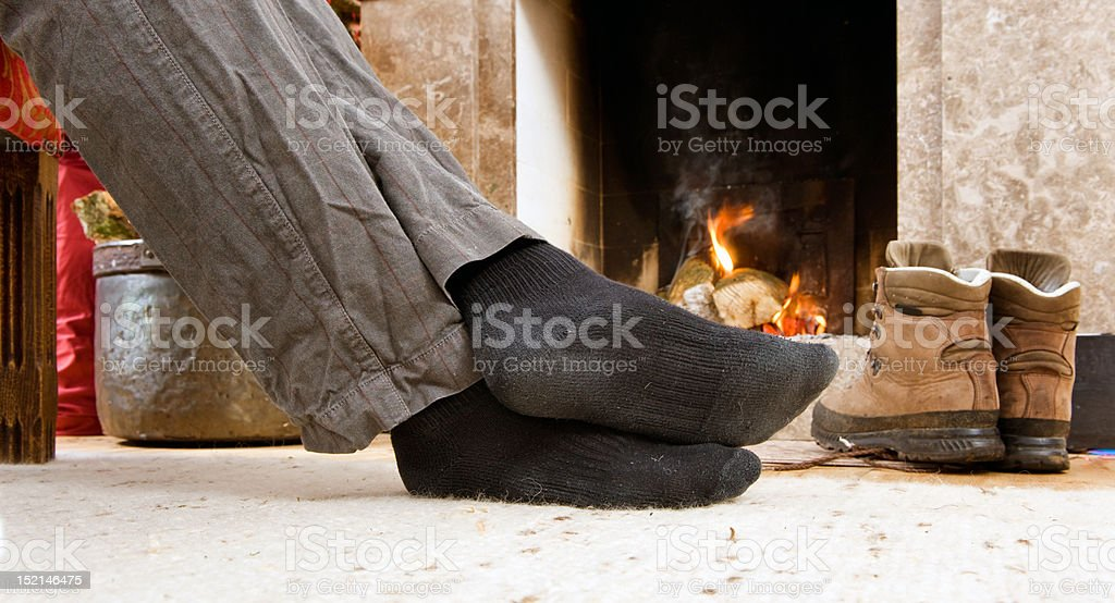 Feet by the fire royalty-free stock photo