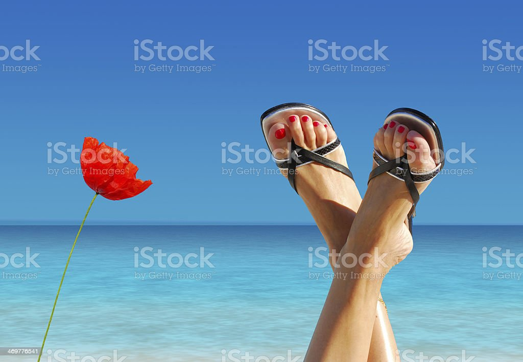 feet crossed on an island paradise royalty-free stock photo