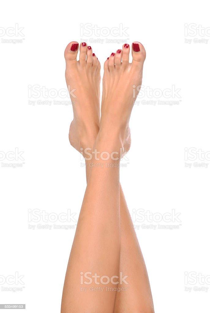 Feet crossed stock photo