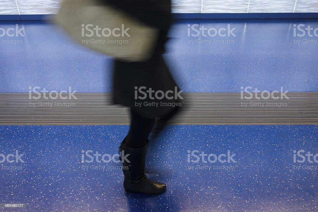 Feet Fast Walking on Blue Floor royalty-free stock photo