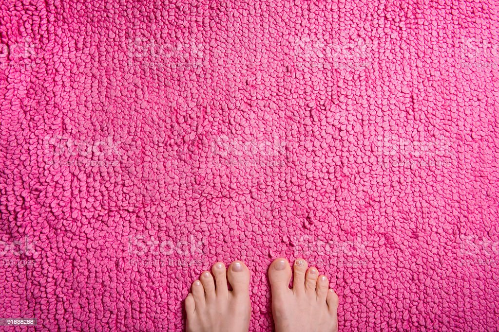 Feet fluffy pink rug stock photo