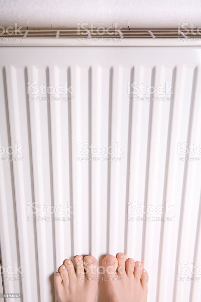 Feet heat radiator stock photo