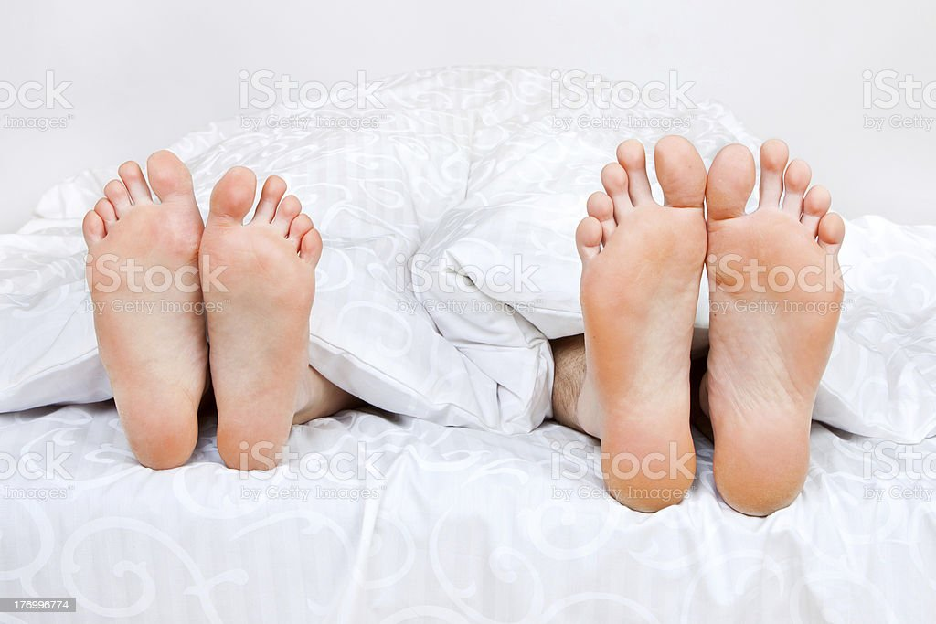feet in a bed royalty-free stock photo